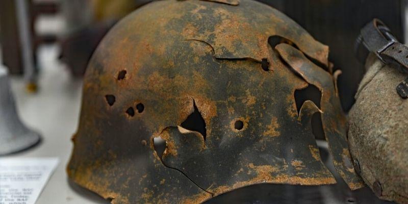 Bullet riddled rusty military helmet